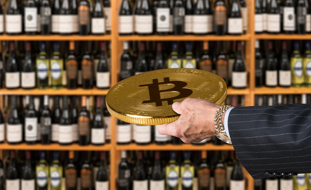 Businessman Offering a Bitcoin
